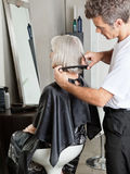 Woman Getting Hair Cut In Beauty Parlor Stock Image