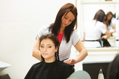 Woman getting hair cut in a beauty salon Stock Images