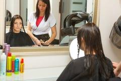 Woman getting hair cut in a beauty salon Stock Photos
