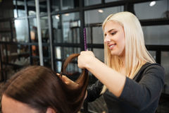 Woman getting a hair cut at the beauty salon Royalty Free Stock Photo