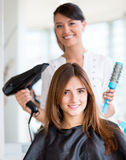 Woman getting a hair cut Royalty Free Stock Image