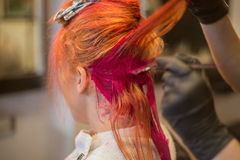 Woman Getting Hair Dyed Red Royalty Free Stock Image