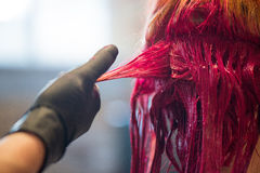 Woman Getting Hair Dyed Red Stock Photography