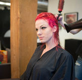 Woman Getting Hair Dyed Red Stock Photo