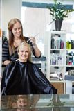 Woman Getting Hair Highlighted Royalty Free Stock Photos
