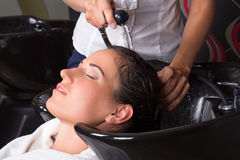 Woman getting a hair wash in beauty salon Royalty Free Stock Images