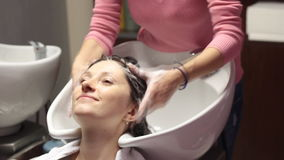 Woman getting a hair wash. At hairdressing salon stock video footage
