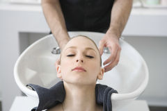 Woman Getting Hair Wash From Hairstylist In Salon Stock Photography
