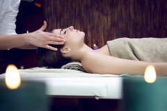 Woman getting head massage in relaxing spa sleeping Royalty Free Stock Photo