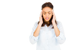 Woman getting a headache. Against white background royalty free stock image