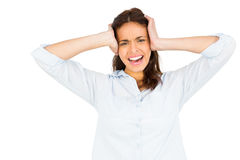 Woman getting a headache. Against white background royalty free stock photos
