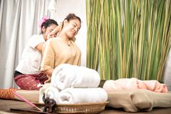 Woman is getting her back stretched in Thai Massage. Treatment Stock Image