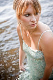 Woman getting her dress wet Stock Photography