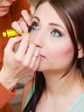 Woman getting her eyelashes makeup done Royalty Free Stock Photography