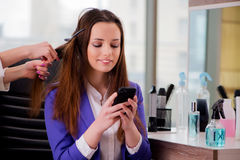 The woman getting her hair done in beauty shop Stock Images