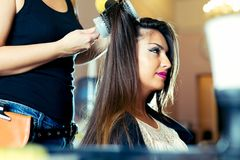 Woman getting her hair dried at the hair salon Stock Photo