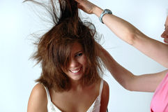 Woman getting her hair styled Royalty Free Stock Photo