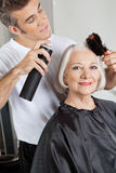 Woman Getting Her Hair Styled. Portrait of senior women getting her hair styled at hair salon Stock Images