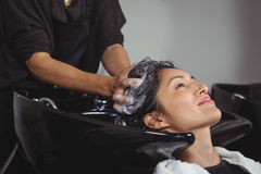 Woman getting her hair wash Royalty Free Stock Images
