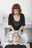 Woman Getting Her Hair Wash In Salon Royalty Free Stock Image