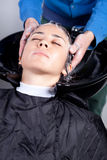 Woman getting her hair washed Royalty Free Stock Images