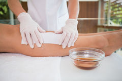 Woman getting her legs waxed by beauty therapist Royalty Free Stock Photography