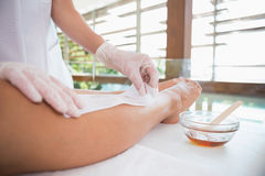 Woman getting her legs waxed by beauty therapist Royalty Free Stock Images