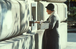 A woman getting her mail Stock Photo