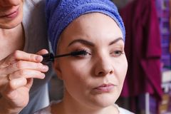 Woman getting her make up done by expert royalty free stock photography