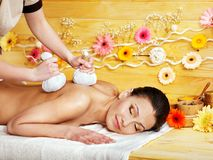 Woman getting herbal ball massage. Stock Image
