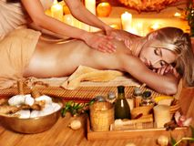 Woman getting herbal ball massage . Blond woman getting herbal ball massage in spa stock photos