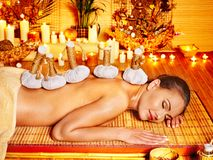 Woman getting herbal ball massage  . Royalty Free Stock Photography