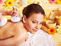 Woman getting herbal ball massage. Royalty Free Stock Photo