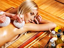 Woman getting herbal ball massage  . Stock Images