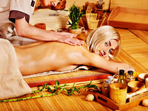 Woman getting herbal ball massage  . Stock Photo