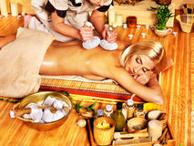 Woman getting herbal ball massage  . Royalty Free Stock Photos