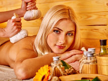 Woman getting herbal ball massage Royalty Free Stock Image
