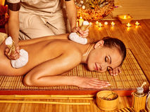 Woman getting herbal ball massage Stock Images
