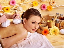 Woman getting herbal ball massage. Woman getting herbal hot ball massage in spa. In frame are hands massage stock images