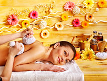 Woman getting herbal ball massage. Stock Photography