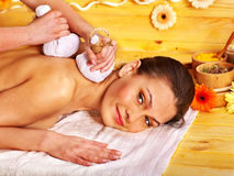 Woman getting herbal ball massage. Royalty Free Stock Photography
