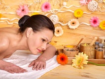 Woman getting herbal ball massage Royalty Free Stock Photos