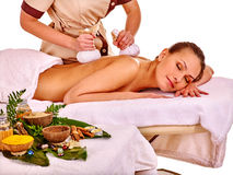 Woman getting herbal ball massage treatments Stock Photography
