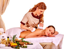 Woman getting herbal ball massage treatments Stock Images