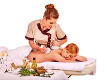 Woman getting herbal ball massage treatments Royalty Free Stock Images