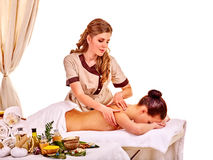 Woman getting herbal ball massage treatments Stock Image