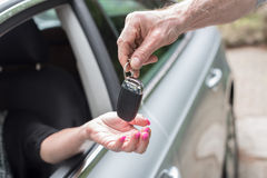 Woman getting his car keys Stock Photography
