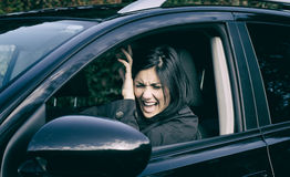 Woman getting hit by car accident shouting Stock Image