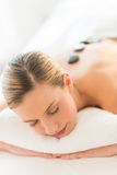 Woman Getting Hot Stone Therapy At Health Spa Royalty Free Stock Image