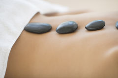Woman Getting Hot Stone Therapy At Spa Stock Images